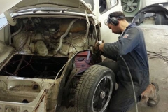 New front quarter being fitted to this '66 Beetle, many other repairs followed.
